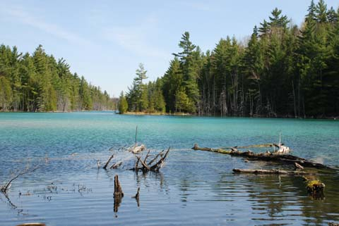 Aquamarine-coloured water in a small lake near Napier Lake